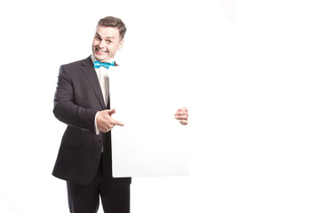 Funny man in a suit shows on a white sheet. On a white background in the studio.