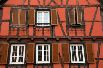 Close up of an old colorful half-timbered house in alsace in france.