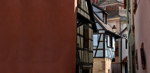 Close up of old colorful half-timbered houses in alsace in france with copy-space.