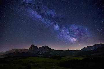 Milky Way over Alpe di Siusi in Dolomites, Italy