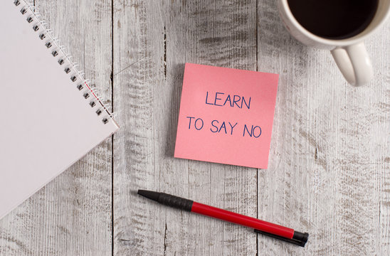 Handwriting text Learn To Say No. Conceptual photo decline or refuse few things before you destroy yourself Stationary placed next to a cup of black coffee above the wooden table