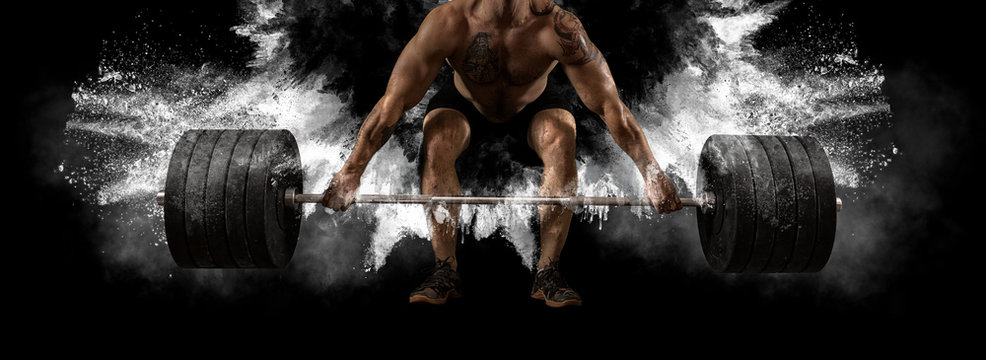 Man workout with barbell at gym