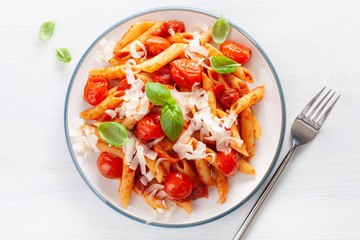 Wall Mural - italian penne pasta with tomatoes parmesan basil