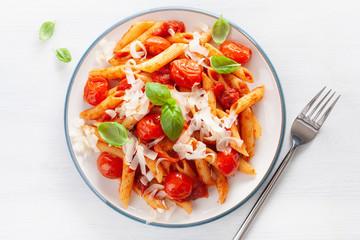 Fototapete - italian penne pasta with tomatoes parmesan basil