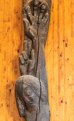 Detail of the crucified hand of Jesus carved on wood