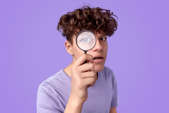 Young detective looking at camera