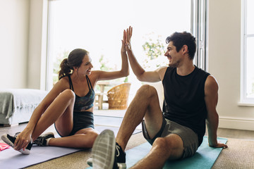 Couple after a successful workout session