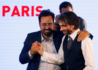Cedric Villani, French mathematician and La Republique En Marche (LREM) member of Parliament, shakes hands with Former Junior Minister in Charge of Digital Mounir Mahjoubi as he attends a political rally as part of the race for Paris City Hall