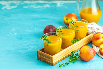 Glass of fresh healthy peach smoothie or juice