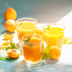 Glass of fresh healthy apricot juice in sunny light