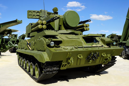 Military combat crawler vehicle with missile launcher, heavy machine gun and mobile antiaircraft radar, modern army industry