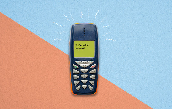 feature phone on paper background