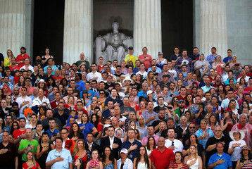 "Attendees stand during the ""Salute to America"" event during Fourth of July Independence Day celebrations at the Lincoln Memorial in Washington"