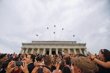 "U.S. Navy Blue Angels perform a flypast at the ""Salute to America"" event during Fourth of July Independence Day celebrations at the Lincoln Memorial in Washington, D.C."
