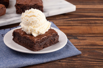 Fototapete - Double Chocolate Brownies Sundae with Vanilla Ice Cream on Top