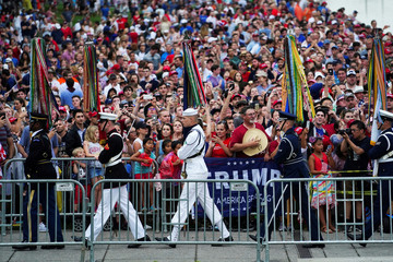 Spectators wait for U.S. President Donald Trump's Fourth of July speech as military members march by at the Lincoln Memorial in Washington