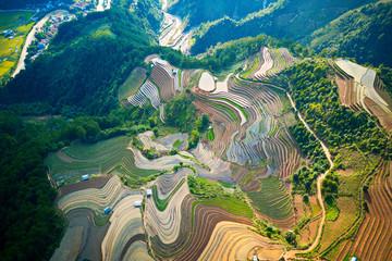 Aerial image of rice terraces in Mu Cang Chai, Vietnam in watering season.