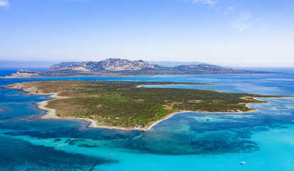 Wall Mural - View from above, stunning aerial view of the Isola Piana island and the Asinara island bathed by a beautiful turquoise clear water. Stintino, Sardinia, Italy.