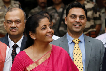 India's Finance Minister Nirmala Sitharaman (C) and Krishnamurthy Subramanian (R), chief economic adviser pose during a photo opportunity outside their office before the presentation of the federal budget in the parliament in New Delhi