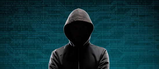 Dangerous hacker over abstract digital background with binary code. Obscured dark face in mask and hood. Data thief, internet attack, darknet fraud, virtual reality and cyber security. Fototapete
