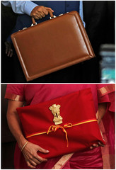 A combination photo shows India's former Finance Minister Jaitley and current Finance Minister Sitharaman arriving to present the budget in Parliament, in New Delhi