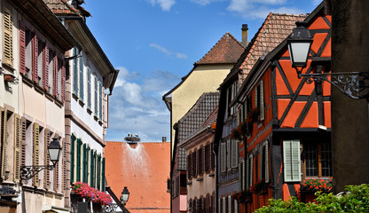 Old colorful half-timbered houses with  stork's nest in alsace in france.