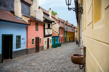 Cobblestone street and colorful 16th century cottages of artisans known as Golden Lane inside the...