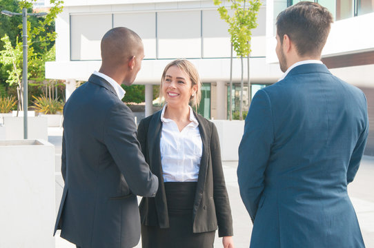 Happy business partners shaking hands. Business man and woman handshaking and finishing meeting. Agreement concept
