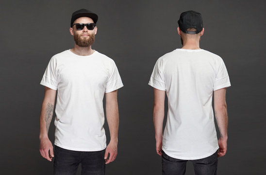 Hipster handsome male model with beard wearing white blank t-shirt and a baseball cap with space for your logo or design in casual urban style. Front and back view