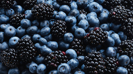 Blackberry and  blueberry background. Top view. Fotomurales