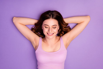 Top above high angle view photo lovely charming cheerful positive youth vacation holiday close eyes thoughtful wavy haircut minded interested singlet modern pink isolated purple background