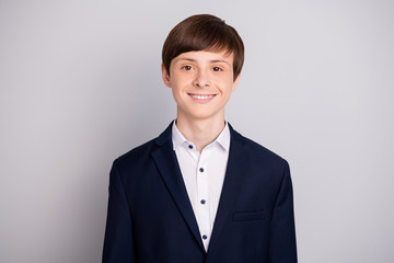 Portrait of lovely charming preteen boy feel content ready work get knowledge dressed fashionable blazer outfit formal shirt isolate grey argent background