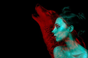Gothic girl and wolf double exposure on black background. Werewolf concept. space for text