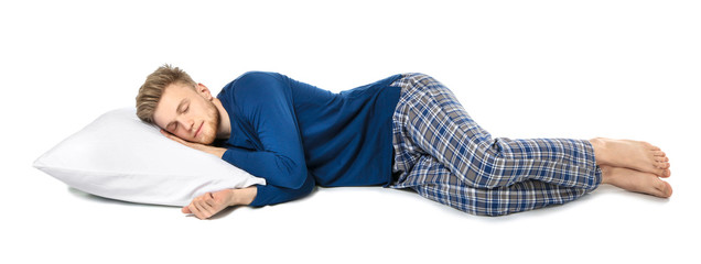 Handsome sleeping man with pillow on white background Wall mural