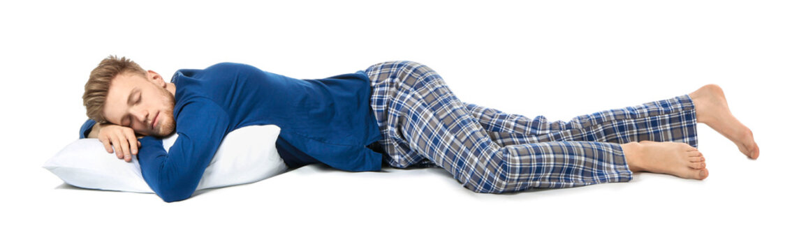 Handsome sleeping man with pillow on white background