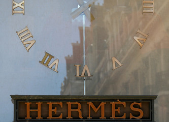 The logo of French luxury group Hermes is seen on a shop window in Paris