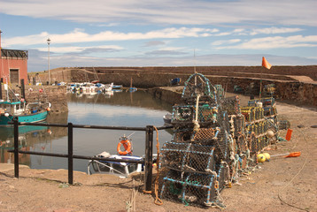 Dunbar little harbour and fishing boats and nets