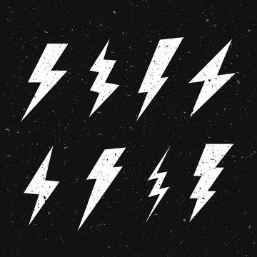 Vector Illustration black and white grunge retro set with lightning bolt signs