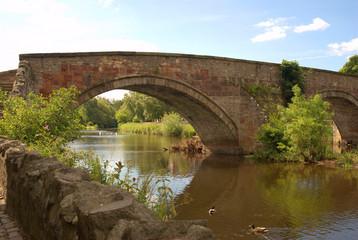 old stone bridge over river Tyne, Haddington in summer