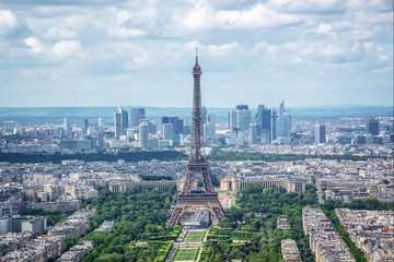 Wall Mural - Aerial scenic view of Paris with the Eiffel tower and la Defense business district skyline, France and Europe city travel concept