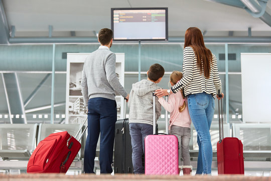 Family looks on the scoreboard in the airport Terminal
