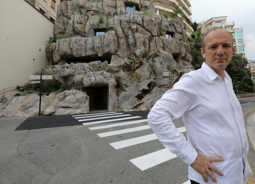 Architect Jean-Pierre Lott poses in front of the luxurious ecological Villa Troglodyte, based on energy saving and the exploitation of natural energies in Monaco
