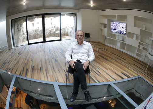 Architect Jean-Pierre Lott poses in the living room of the luxurious ecological Villa Troglodyte, based on energy saving and the exploitation of natural energies in Monaco
