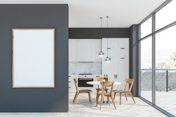 Gray and white kitchen, balcony and poster