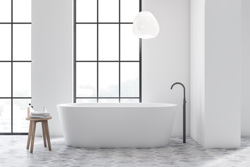 White bathroom interior with tiled floor