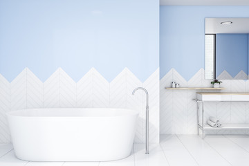 White and blue bathroom with tub and sink