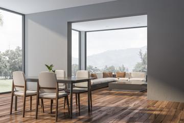Gray dining room corner with sofa