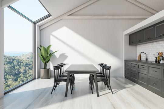 Attic Scandinavian kitchen interior with table