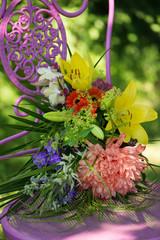 Beautiful flower bouquet on a garden chair