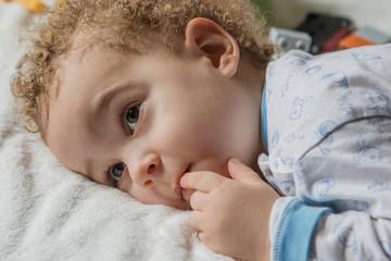 Portrait of little boy in pyjamas before going to sleep